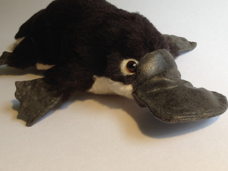 Brown mohair platypus with faux leather bill and feet