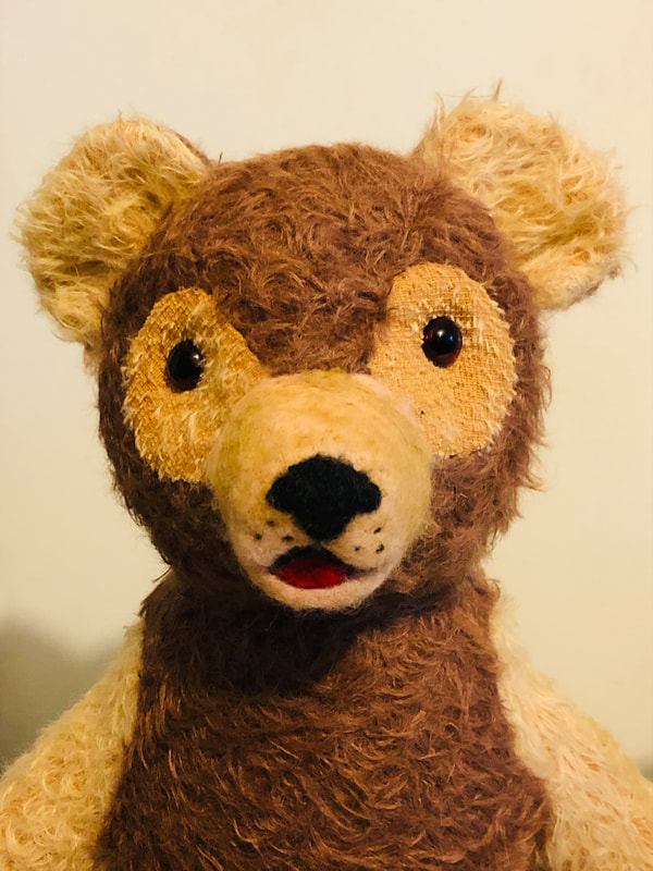 Gold and brown scruffy mohair teddy bear with needle felted face.